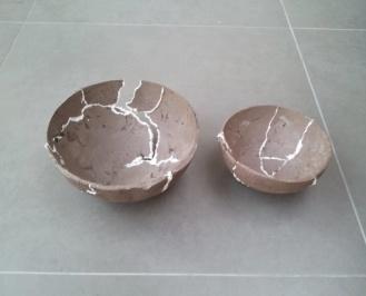 broken - brown ceramic bowls