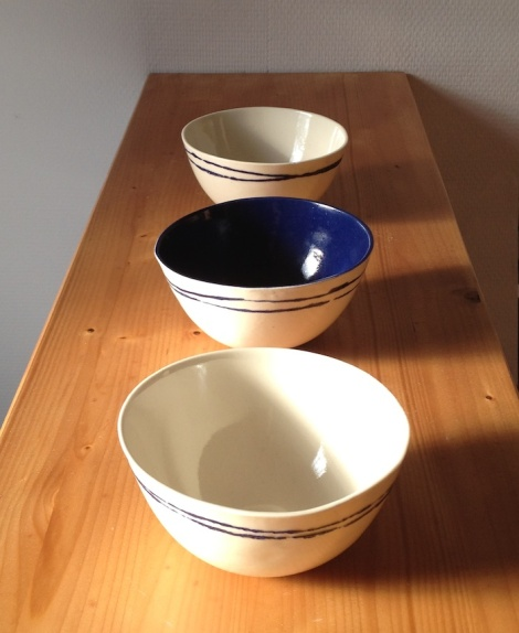 white and blue ceramic bowls
