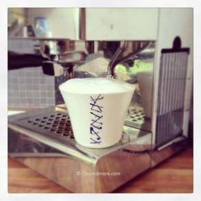 white porcelain mug with blue ribbons, perfect for coffee